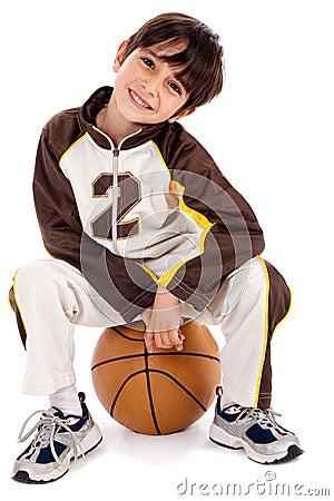 Cute kid sitting on the ball