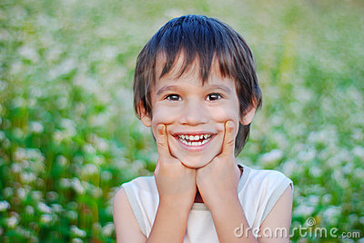 Cute kid with smile grimace