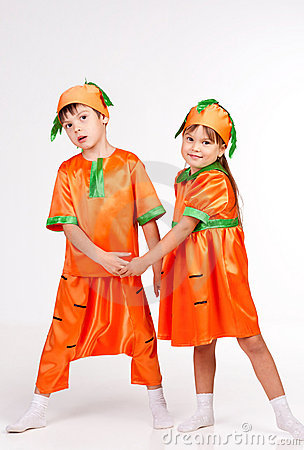 Cute kids in carrot fancy dress