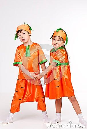 Cute kids in carrot fancy dress