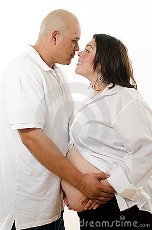Cute latin american pregnant couple