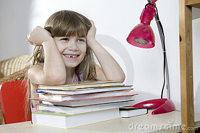 Cute laughing girl resting from homework