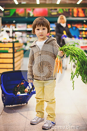 Free Cute Little And Proud Boy Helping With Grocery Shopping, Healthy Royalty Free Stock Photos - 52665368