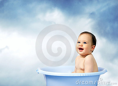 Cute little baby bathed in a bath.Outdoor