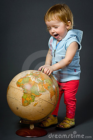 Cute little baby with globe