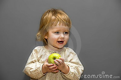 Cute little baby with green apple