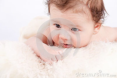 Cute little baby infant toddler on white blanket portrait