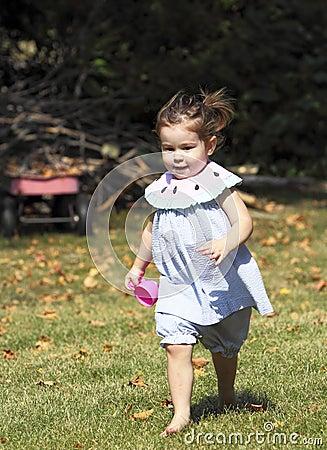Cute little barefoot girl.
