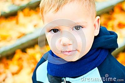 Cute Little Blonde Boy in Blue Scarf