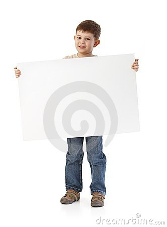 Cute little boy with big blank sheet