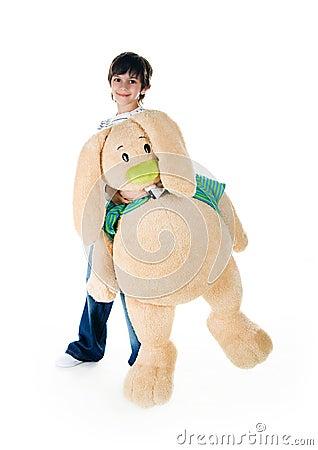 Cute little boy with a big rabbit