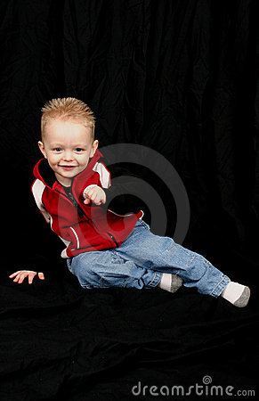 Cute little boy on black