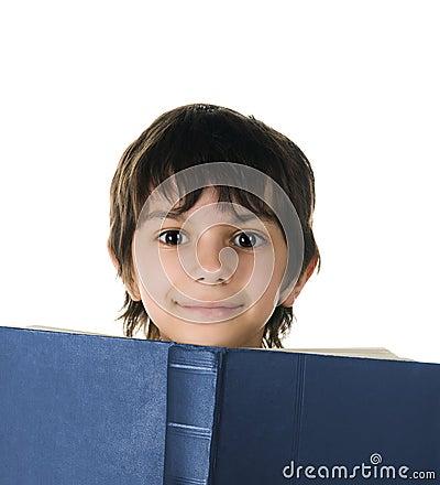 Cute little boy with a book