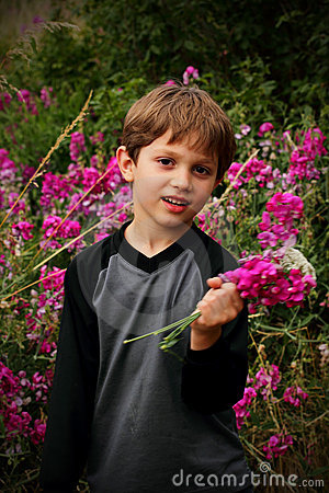 Cute little boy with a bouquet of flowers