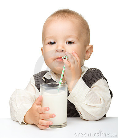 Cute little boy is drinking milk