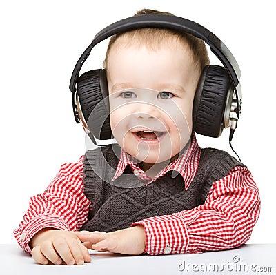 Free Cute Little Boy Enjoying Music Using Headphones Royalty Free Stock Image - 25800206
