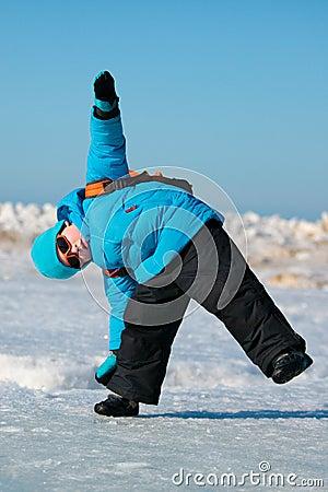 Cute little boy having fun on cold winter day