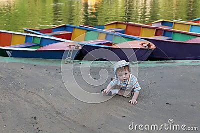 Cute little boy by lake