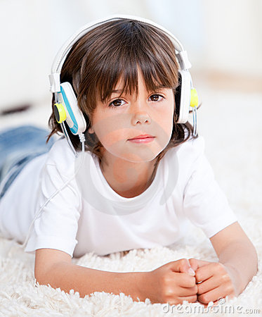 Cute Little  Boy Listening Music Lying On Floor Stock Photo - Image: 14366090