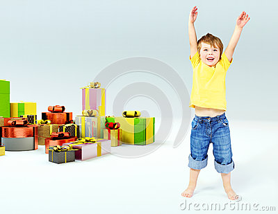 Cute little boy with lots of gifts