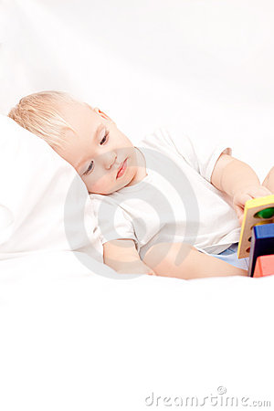 Cute little boy lying on the bed