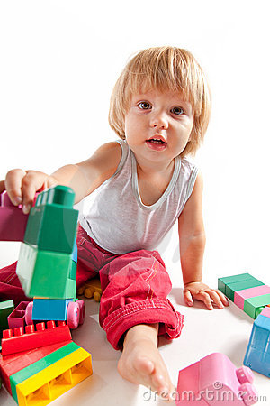Cute little boy playing with blocks