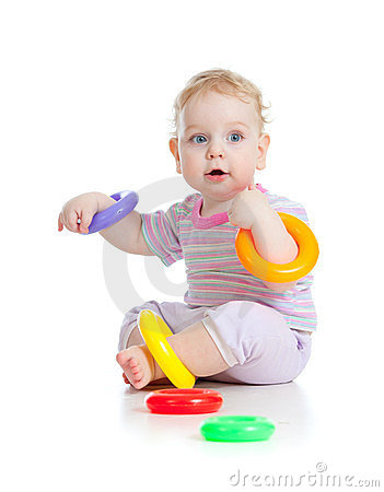 Cute little boy playing colorful toys