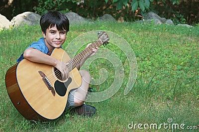 Cute Little Boy Playing Guitar