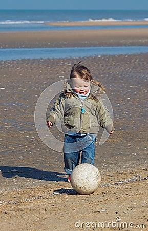 Cute little boy playing soccer