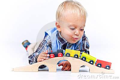 Cute little boy playing trains