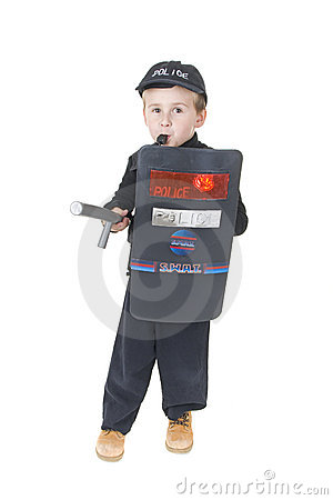 Cute little boy in policemans outfit
