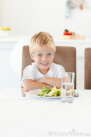 Cute little boy ready to eat his salad