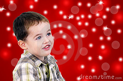 Cute little boy on red background with lights