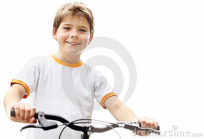 Cute little boy standing with his bicycle outside
