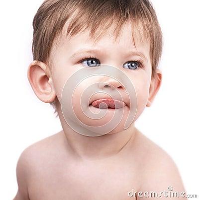 Cute little boy, tongue out