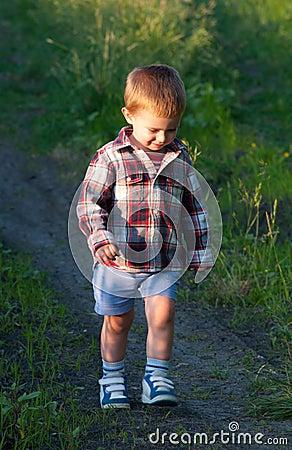 Cute little boy walking in the nature