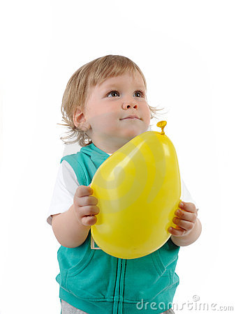Cute little child smiling and holding a baloon