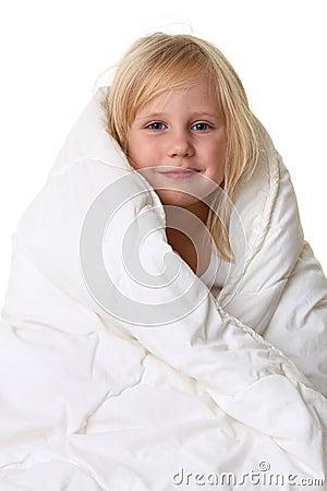 Cute little girl in blanket