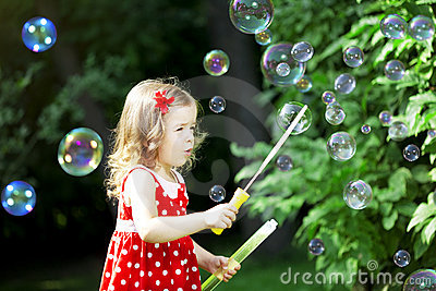 Cute little girl with bubbles
