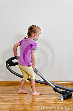 Cute little girl cleaning floor