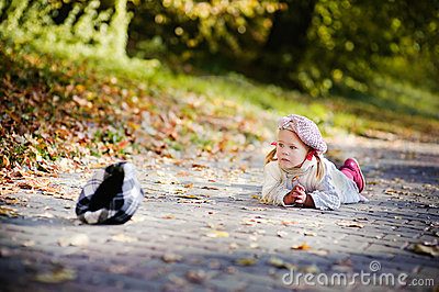 Cute little girl crying in autumn park