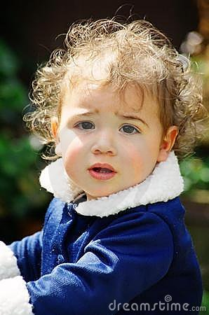 Cute little girl with curly hair