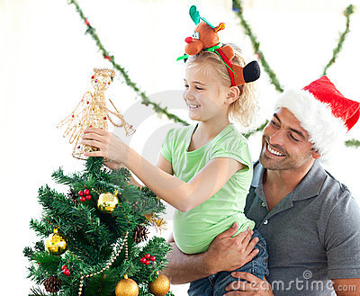 Cute little girl decorating the christmas tree