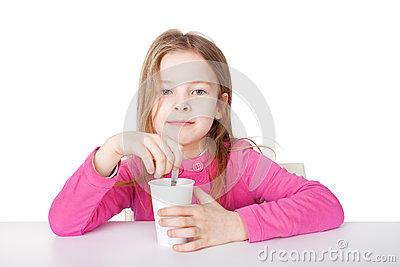 Cute little girl is drinking tea