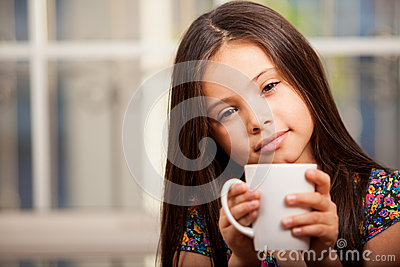 Cute little girl drinking tea