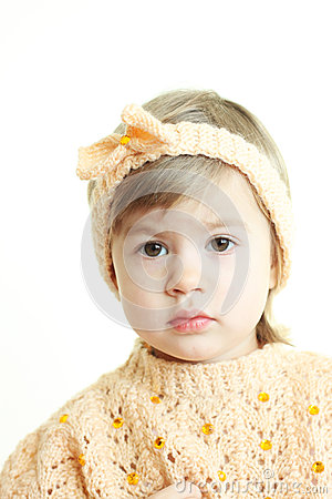 Cute little girl in handmade clothes