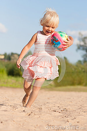 Cute little girl having fun on beach