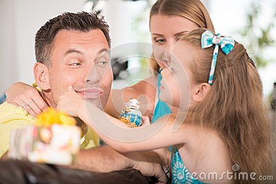 Cute little girl having fun with parents