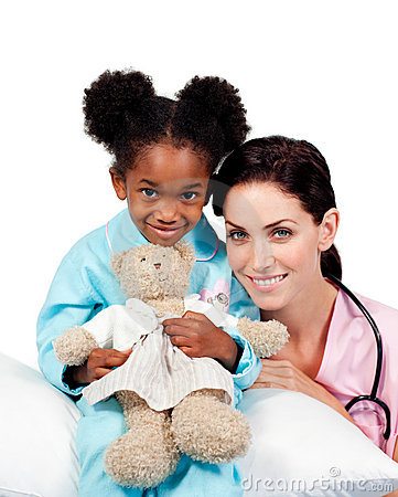 Cute little girl with her doctor smiling
