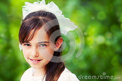 Cute Little Girl in her First Communion Day